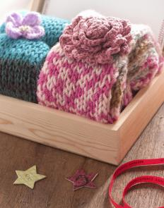 At its most basic, knitting is the art of repeatedly knotting yarn with two sticks or needles.