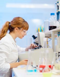 Environmental scientists may analyze samples in a laboratory.