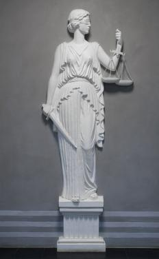 A statue of Lady Justice serves as a reminder for the need for impartiality in the legal system.