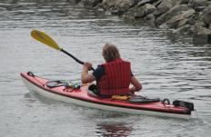 A fitness vacation might include kayaking.