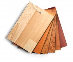 A laminate cutter is used to cut laminate flooring planks.