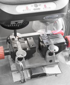 A certified locksmith must be knowledgeable about tools like a key cutting machine.