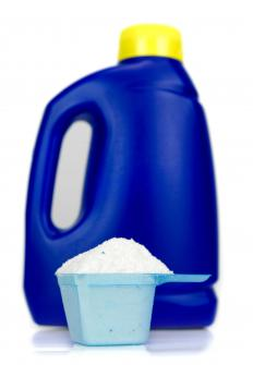 A bottle and cup of laundry detergent. Citric salts are often added to laundry detergent to make it more effective.