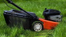 Lawn mowers typically cannot cut grass close to edges of objects, such as houses or fences.