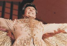 Liberace might have used Gorgeous George's influence to craft his public persona.