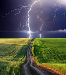 Lightning from a thunderstorm striking a field.