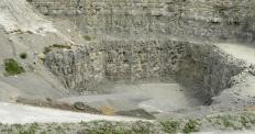 Limestone is quarried from the ground.
