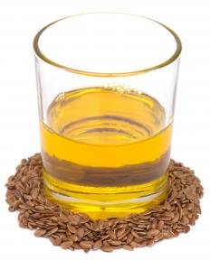 Flaxseed oil and brown flax seeds.