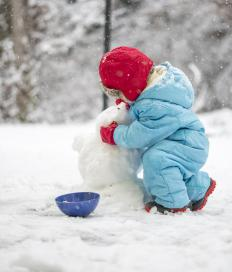 Making snowmen is a good way to get exercise during the winter.
