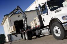 A loader crane is used to load materials on and off of a truck.