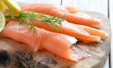 Lox is a thin filet of cured, cold smoked salmon that can top a bialy.