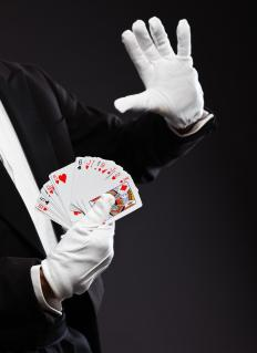 A magician may perform a variety of different tricks in front of an audience.
