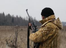 A hunter with an illuminated rifle scope should check the local laws and regulations before using it.
