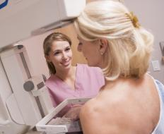 Breast calcifications are revealed through a mammogram.