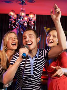 A karaoke machine for guests is a more budget friendly activity for a party as opposed to hiring a musician.
