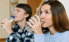 Drinking large amounts of fluids and delaying urination for as long as possible may be one way of gradually treating bladder capacity problems.