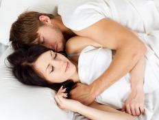 Guests tend to sleep where they're told, so it's up to your parents whether you and your partner can share a bedroom.