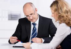 A loan originator evaluates loan applications and gathers information before financing a loan.