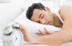 Moving the alarm clock away from the bed can prevent a person from hitting the snooze button too often.