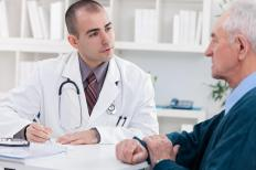 A physician will discuss the options for testicular cancer treatment with a patient.