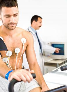 Man getting an EKG. In an EKG, electrodes are placed on the skin to detect the heart's electrical activity.