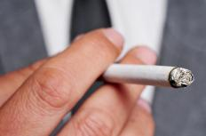 Smoking causes infections that create green phlegm.