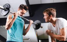 When curling a barbell, individuals should take a deep breath before the curl and exhale as the barbell is moved toward the body.