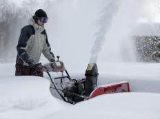 Metal skids provide a durable, ski-like surface on which the snow blower rides.