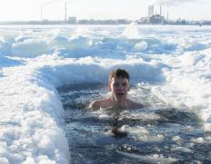 In a polar bear plunge event, people dive into icy water for fun, charity or physical health.