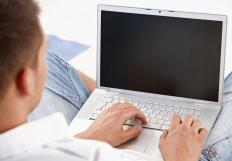 Freelance copywriters might telecommute using a laptop.