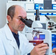 To find out if cancer cells are moderately differentiated adenocarcinoma, a specialist will examine a specimen under a microscope.