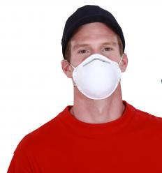 A dust mask should be worn while using a wood turning lathe.