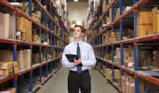 A distribution manager oversees the shipping of goods for a company.