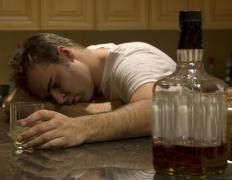 Someone suffering from chronic pain may turn to alcohol as a way to cope.