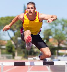 Hurdles are a running event in which the participants must leap over barriers.