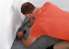 The edges of fitted carpets are secured to the floor, close to the wall.