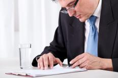 A forensic accountant interprets financial evidence.
