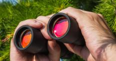 Optical glass is used in binoculars to help distant objects appear closer.