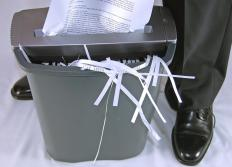 Shredding documents that contain sensitive information can help corporations maintain physical information security.