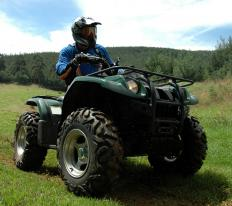 A 90-degree steel stem is often used for protection while providing air access to the ATV tubes.