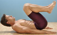 Reverse crunches help work the lower abdominal muscles of the stomach.