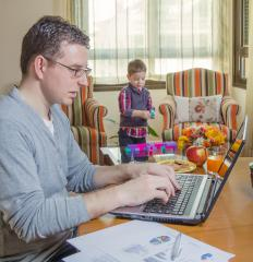 Some telecommuters can work while their children are home, saving money on daycare expenses.