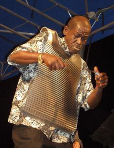 The rubberboard, or frottoir, is a type of percussion instrument used in zydeco music or festivals displaying various types of instruments.