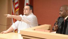 Witnesses are usually not allowed to site in the courtroom before they are called to the stand.