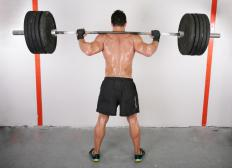 To perform a leg squat, the weight is positioned on a lifter's shoulders.
