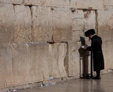 Hasidic man praying at the Kotel (Wailing Wall).