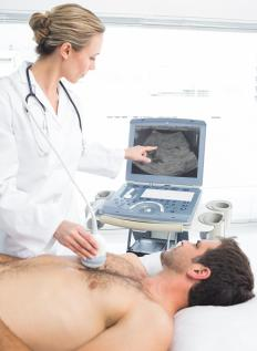Ultrasound transducers may be placed on the chest during the diagnosis of heart conditions.