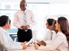 An operations expert may give presentations to co-workers on a company's business activities.