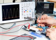 An oscilloscope can be used to measure the efficiency of the power transfer through the bench power supply.