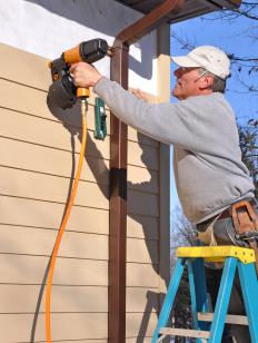 A nail gun may be used to install siding.